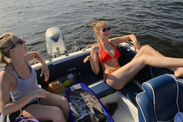 girls boat laughing